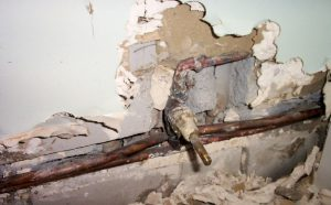 does insurance cover water leaks in walls