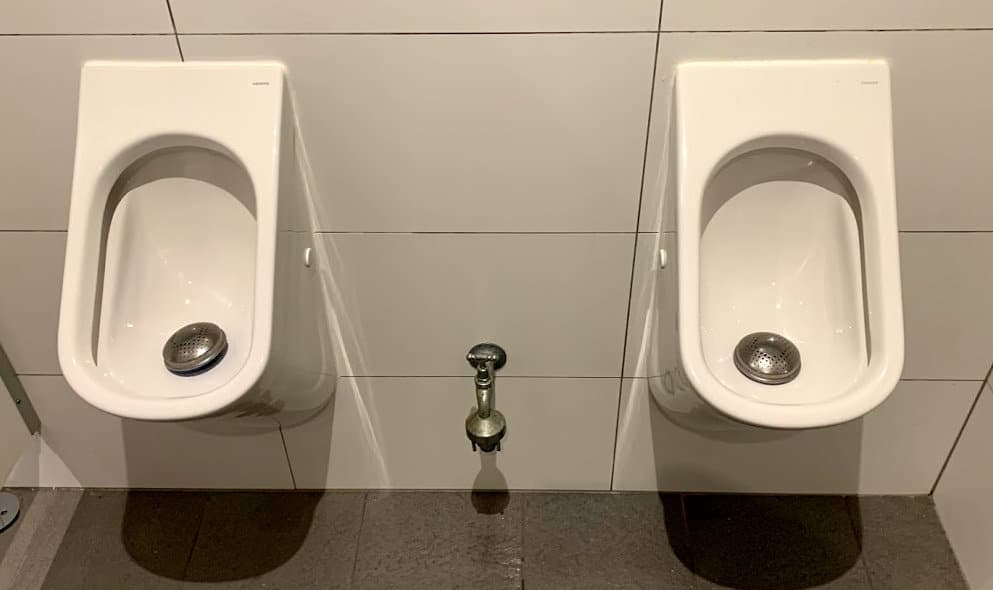 Caroma H20 waterless urinals requiring urinal servicing by Whywait Plumbing Services