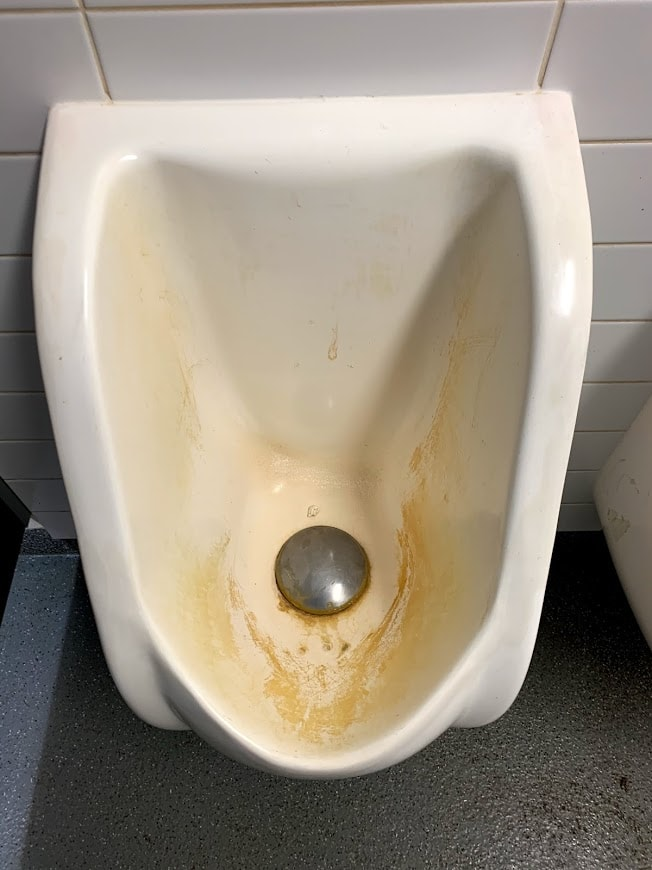 Britex waterless urinal before experiencing urinal servicing from Whywait Plumbing
